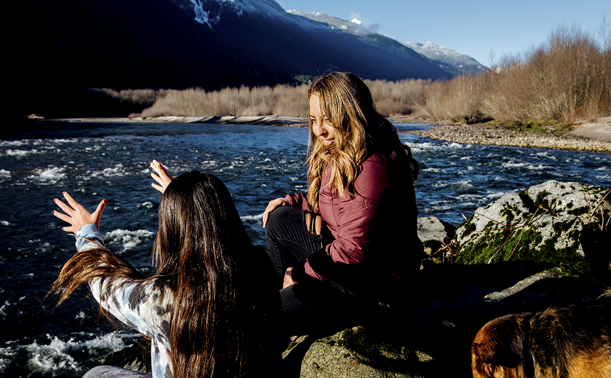 April Newman with girls by a river