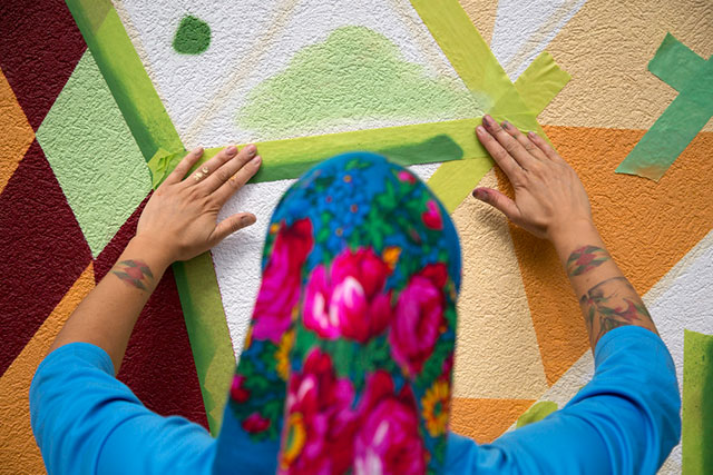 Mural artist Carrielynn Victor tapes her wall on Aug. 31, 2018. Victor was one of ten artists commissioned to create murals to celebrate Capilano University's 50th anniversary. Check out our project (add link here to mural story) on the mural artists.
