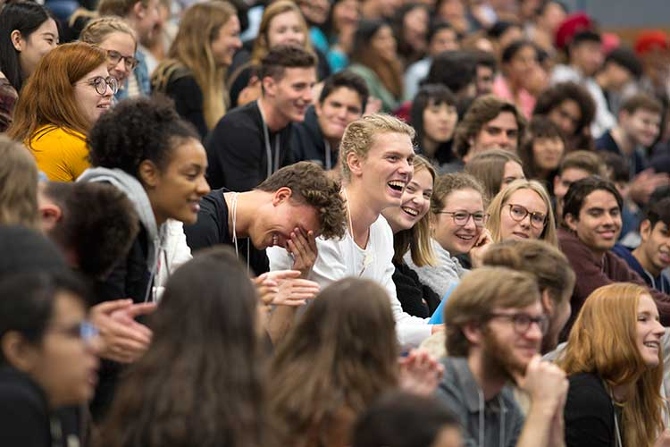 Students laugh during a presentation by Dr. Chris Bottrill at the Centre for International Experience's International Student Orientation on Thursday, Aug. 31, 2018.