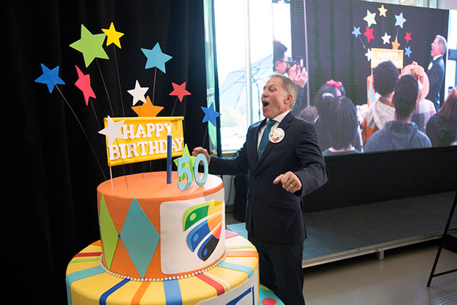 President Paul Dangerfield blows out a candle at the official birthday celebration on Sept. 10, 2018. The event featured musical performances, special guests, a message from Prime Minister Justin Trudeau and a reception for the first students who attended the university when its doors opened in 1968.