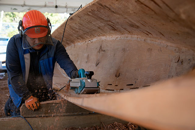 Master carver Ses siyam works on the CapU50 Legacy Canoe, named Skw'cháys, on April 1, 2019.