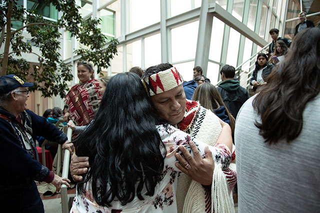 Master carver Se siyam (Ray Natraoro) receives a hug prior to the Legacy Canoe Awakening and Naming Ceremony on Thursday, April 11, 2019. The ceremony marked the completion of the CapU50 Legacy Canoe, named Skw'cháys.