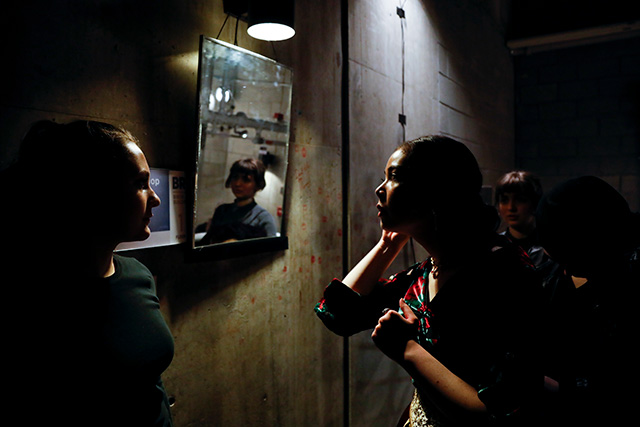 "Camryn Smith looks at herself in the mirror between scenes during a dress rehearsal performance of ""Macbeth"" at the BlueShore Financial Centre for the Performing Arts on Nov. 13, 2019. (Photo by Taehoon Kim)"