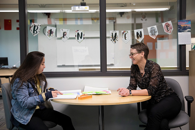 Language instructor Catherine Gloor works with a student in the new Language Resource Centre on Nov. 21, 2019. (Photo by Taehoon Kim)