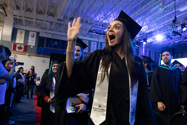 Greeting loved ones during Convocation ceremonies on Feb. 21, 2020. (Photo by Tae Hoon Kim)
